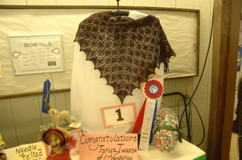Winning shawl, very dark brown and red knitted with handspun