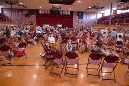 Gymnasium covered with chairs and spinning wheels