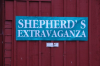 Sign on red barn, Shepherd's Extravaganza.